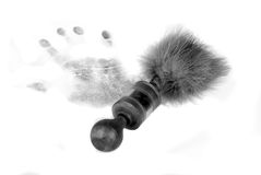 Handprint and brush. With marabou feathers stock image