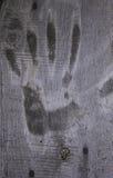 Handprint en una superficie de madera Fotografía de archivo libre de regalías