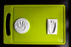Handprint et empreinte de pas de bébé Photographie stock libre de droits