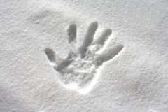 Handprint in fresh snow Stock Photos