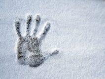 A handprint on fresh snow. stock photos