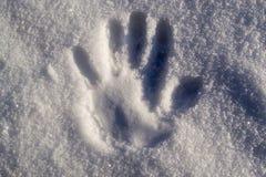Handprint i snö Arkivfoton