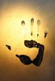 Handprint on ice glass Stock Photo