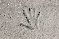 Handprint. Imprint of a hand in concrete Stock Images