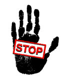 Handprint labeled Stop!. Black palm print with a red sign Stop! on a white background Stock Images