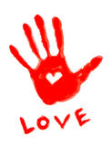 Handprint with love symbol Royalty Free Stock Image