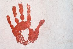 Handprint on the plastered wall. bright paint. Stop concept. Handprint on plastered wall. imprint of a bloody hand. art concept of anxiety, danger. stop concept stock illustration