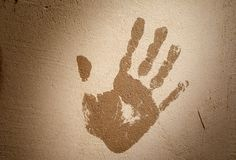 Handprint on the plastered wall. Stop concept. Toning. Fingerprinting. handprint on the plastered wall. Stop concept. dark toning stock illustration