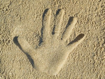 Handprint in the sand. Optical illusion - Handprint in the sand Royalty Free Stock Photography