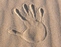 Handprint in the sand. An handprint in the sand on the beach royalty free stock photos