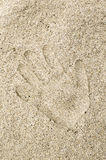 Handprint in the sand Stock Images