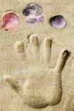 Handprint on sand beach Royalty Free Stock Photo