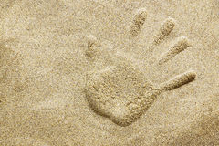 Handprint on sand beach Royalty Free Stock Image