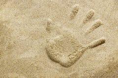 Handprint on sand beach Royalty Free Stock Image