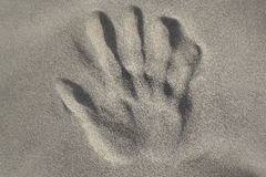 Handprint in the sand Royalty Free Stock Photo