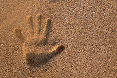 Handprint in the sand Stock Photography