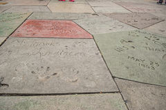 Handprint And SignatureTCL Chinese Theatre is a cinema on the Hollywood Walk of Fame in Los Angeles. Stock Photos