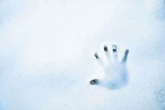 Handprint in the snow. Hand print in bluish white snow in winter Royalty Free Stock Photo