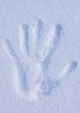 Handprint on a snow Royalty Free Stock Photos