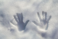 Handprint in the snow Stock Images