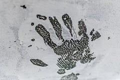 Handprint sulla pittura bianca Fotografia Stock Libera da Diritti