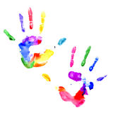 Handprint in vibrant colors of the rainbow. Left and right handprints painted in different colors on white background Royalty Free Stock Images