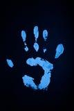 Handprint weißer Lack unter UV Stockfoto