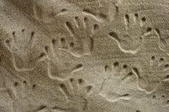 Handprints в песке Стоковая Фотография