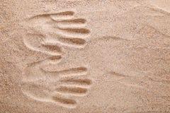 Handprints. On the beach sand royalty free stock photo