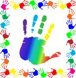 Handprints border with big rainbow palm in center. Bright  vector illustration with multicolored handprints border and big rainbow palm print silhouette in Royalty Free Stock Images