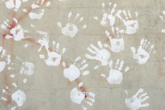 Handprints on cement wall. Handprints on wall - white hand prints on grey cement Stock Photo