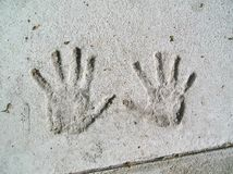 Handprints in cemento Immagine Stock