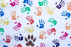 Handprints of children of different colors on a white background stock image