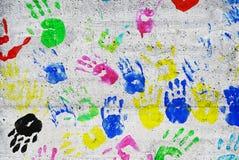 Handprints coloridos de los niños Fotografía de archivo libre de regalías