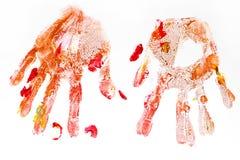 Handprints coloridos pintados a mano por los niños aislados en un blanco Foto de archivo
