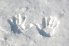 Handprints dans la neige Photos libres de droits
