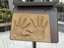 Handprints de Jackie Chan de la avenida de estrellas, Hong Kong Imagen de archivo libre de regalías