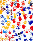 Handprints de los niños en pintura en una pared Imagen de archivo