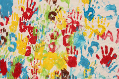 Handprints in different colors in a mural. Royalty Free Stock Images