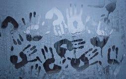 Handprints em um vidro de janela congelado Fotografia de Stock Royalty Free