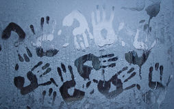 Handprints on a frozen window glass royalty free stock photography