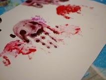 Handprints of a little baby girl on white paper - baby handprint / fingerprint painting. Selective focus of handprints of a little baby girl on white paper stock image