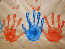 Handprints Made With Paint On Brown Paper Stock Image