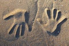 handprints mitt emot två Royaltyfri Foto