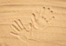 Handprints på sand Royaltyfri Fotografi