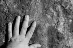 Handprints on rock Stock Photography