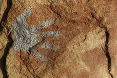 Handprints on rock Stock Image
