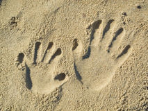 Handprints in the sand Royalty Free Stock Photography