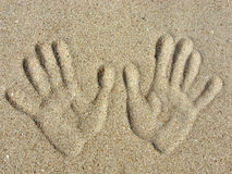 Handprints on a sand. Left and right handprints on a sand Royalty Free Stock Photos