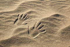 Handprints in the sand Royalty Free Stock Images